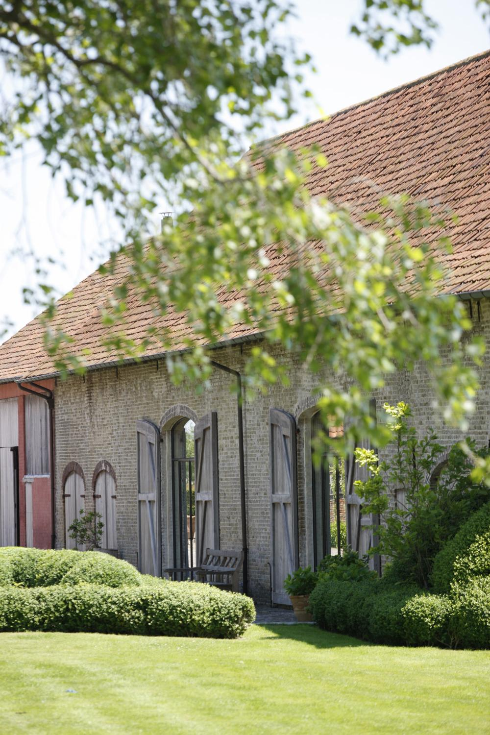 Historic buildings and garden beauty shine at The Little Monastery, a wonderful B&B near Bruges. Come enjoy photos and a tour of Belgian Design Style Inspiration from antiques dealers Alain and Brigitte Garnier.