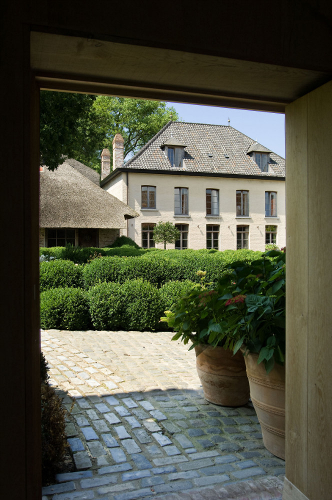 Breathtaking architecture and boxwood gardens at The Little Monastery, a wonderful B&B near Bruges. Come enjoy photos and a tour of Belgian Design Style Inspiration from antiques dealers Alain and Brigitte Garnier.