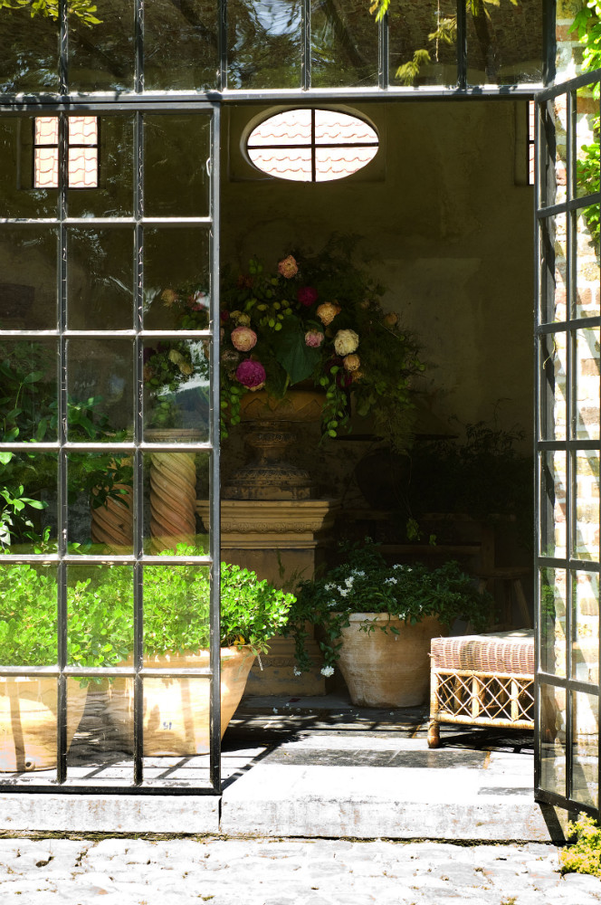 A breathtaking peek beyond steel and glass doors at potted bliss at The Little Monastery. Come enjoy photos of Old World Style and Rustic European Antiques in a Serene Countryside Setting in Belgium.