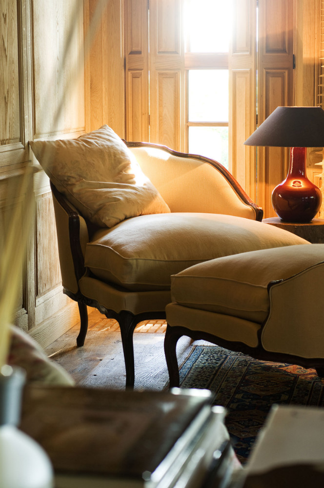 A breathtaking vignette with natural light, a curvy chair, and gourd style lamp in a Belgian style interior at The Little Monastery. Come enjoy photos of Old World Style and Rustic European Antiques in a Serene Countryside Setting.